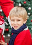 Cute Boy Receiving Gift From Santa Claus Stock Photo