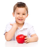 Cute boy with red apples Stock Images
