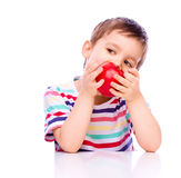 Cute boy with red apples Royalty Free Stock Images