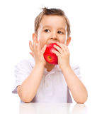 Cute boy with red apples Stock Photography