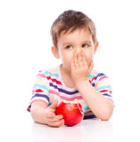 Cute boy with red apples Stock Photos