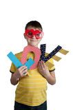 Cute boy in red glasses with paper letters love Royalty Free Stock Image