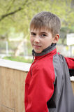 Cute boy in red jacket Stock Photos