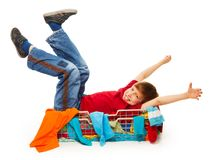 Cute boy in red t-shirt having fun. Cute boy in red t-shirt pranking in clothing store Stock Images