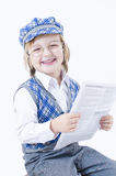 Cute Boy reding newspaper Royalty Free Stock Images