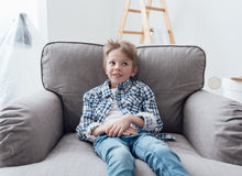Cute boy relaxing at home Royalty Free Stock Photos