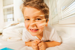 Cute boy resting at home in sunny morning Royalty Free Stock Photo