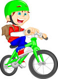 Cute boy riding bicycle Stock Image