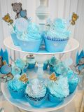 The boy`s birthday, blue, Birthday Boy Blue Party with Candy Presents and Cupcakes stock images