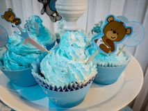 The boy`s birthday, blue, Birthday Boy Blue Party with Candy Presents and Cupcakes royalty free stock image