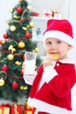 Cute boy in Santa hat Stock Photos
