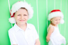 Cute boy in a Santa hat Stock Images