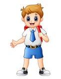 Cute boy in a school uniform waving Royalty Free Stock Image
