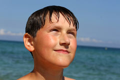 Cute boy on the sea Royalty Free Stock Image