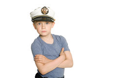 Cute boy in a sea cap Royalty Free Stock Photos