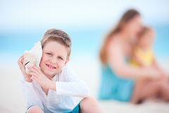 Cute boy with seashell Stock Photography