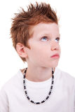 Cute boy with a serious look, looking up Stock Photography