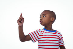 Cute boy shaking finger saying no. On white screen Stock Photos
