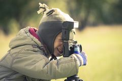 Cute boy shooting a photography in autumn park Stock Photography