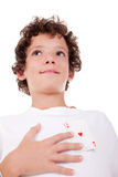 Cute boy showing an ace of hearts. In place of the heart, isolated on white, studio shot Stock Images