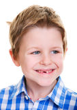Cute boy showing missing tooth. Studio portrait of cute 6 years old boy showing his missing tooth Royalty Free Stock Images