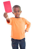 Cute boy showing red card Royalty Free Stock Photos