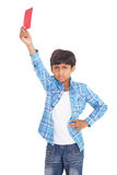 Cute boy showing red card Stock Image