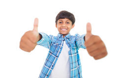 Cute boy showing thumbs up Stock Images
