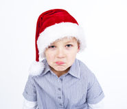Cute boy shows upset expression Royalty Free Stock Photography