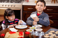 Cute boy and sister baking cookies Stock Photography