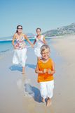 Cute boy with sister and mother on the beach Royalty Free Stock Photo