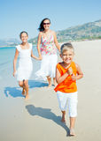 Cute boy with sister and mother on the beach Stock Images