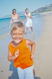 Cute boy with sister and mother on the beach Royalty Free Stock Image