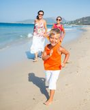 Cute boy with sister and mother on the beach Stock Photo