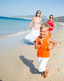 Cute boy with sister and mother on the beach Royalty Free Stock Photography