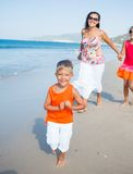 Cute boy with sister and mother on the beach Stock Image