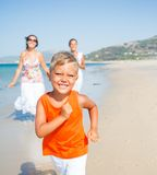 Cute boy with sister and mother on the beach Stock Photography