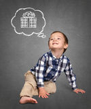 Cute boy siting on the floor Royalty Free Stock Image