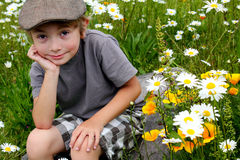 Cute Boy Sitting stock images