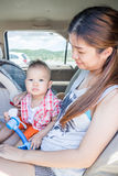 Cute boy sitting in the car with his mother Royalty Free Stock Photography