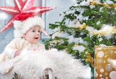 Cute boy sitting in the Christmas basket. Cute boy sitting in the Christmas wicker basket Stock Photography