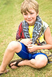 Cute Boy Sitting in Grass Royalty Free Stock Images