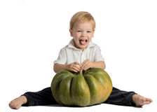 Cute boy sitting with pumpkin Royalty Free Stock Photos