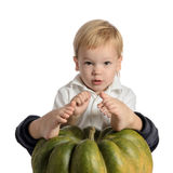 Cute boy sitting with pumpkin Royalty Free Stock Photography