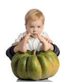 Cute boy sitting with pumpkin Royalty Free Stock Photo
