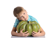 Cute boy sitting with pumpkin Royalty Free Stock Image