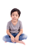 Cute boy sitting on white background Stock Images
