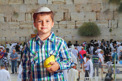 Cute boy in skullcap with the etrog. Sukkot at Western Wall of the Temple in Jerusalem. Cute seven year old boy in white skullcap with the etrog Royalty Free Stock Photos