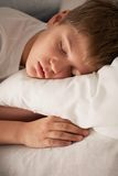 Cute boy sleeping on pillow. Cute boy sleeping on white pillow Royalty Free Stock Photos