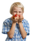 Cute boy smelling a bunch of tomatoes Stock Images